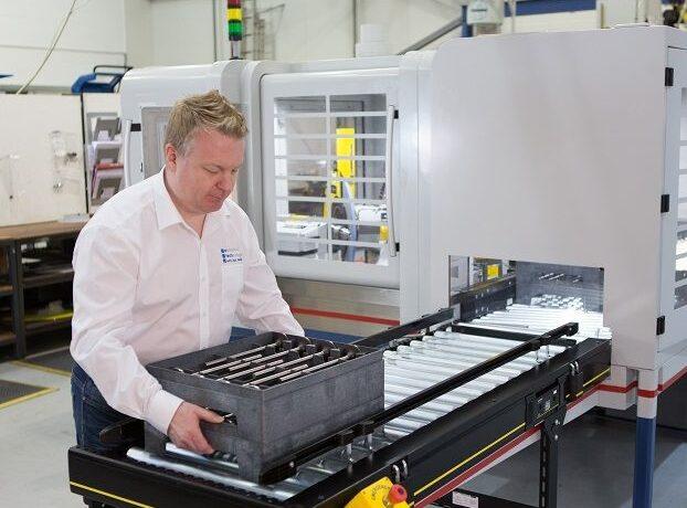 E-tech worker operating a machine